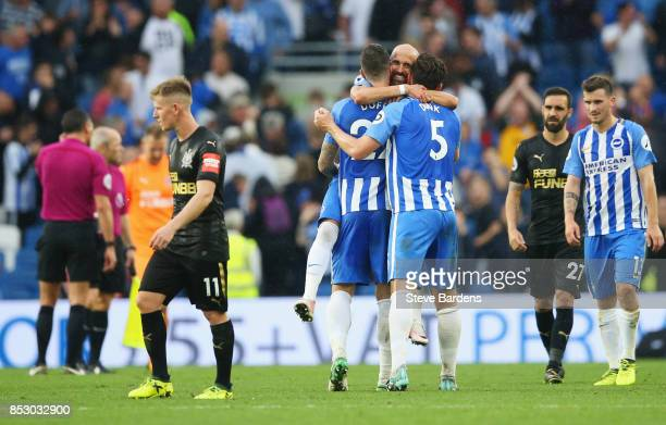Brighton players celebrate victory as Matt Ritchie of Newcastle United looks dejected after the Premier League match between Brighton and Hove Albion...