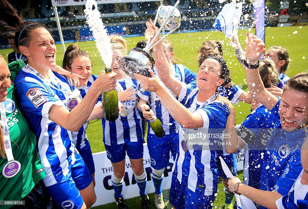 Brighton players celebrate with the trophy following the WPL Playoff match between Brighton & Hove Albion WFC and Sporting Club Albion LFC at Adams Park on May 29, 2016 in High Wycombe, England.