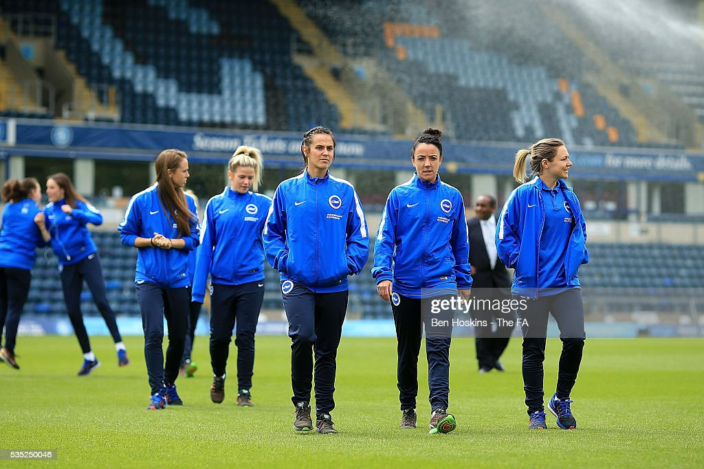Brighton players inspect the pitch ahead of the WPL Playoff match between Brighton & Hove Albion WFC and Sporting Club Albion LFC at Adams Park on May 29, 2016 in High Wycombe, England.