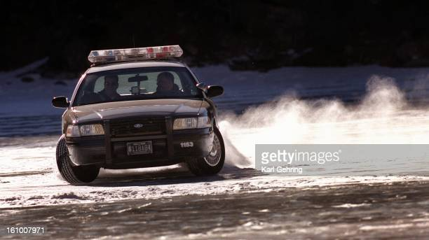 Brighton Police department detectives Mark Rule and Randy Olson turned their patrol car out of a skid on the frozen surface of Georgetown Lake...