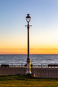 A Lamp Post on the Promenade at Brighton, with a Sunset Sky Behind