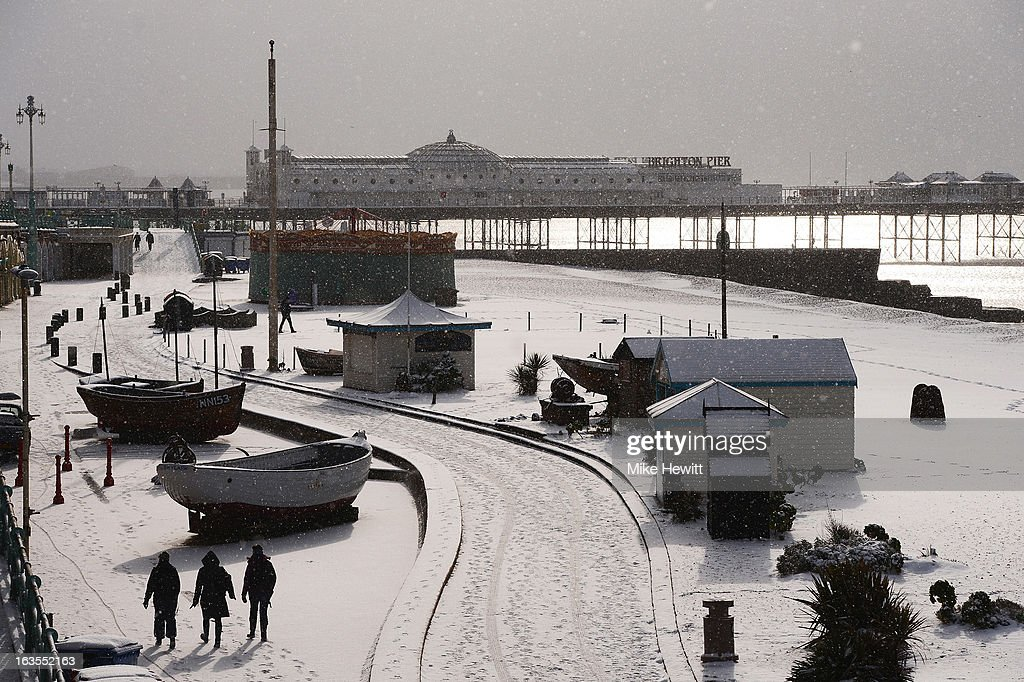 Brighton seafront is covered in a blanket of snow on March 12, 2013 in Brighton, England. Snowfall is affecting Southern parts of the UK with yellow weather warnings issued for London and South-East England.