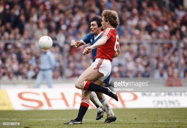 Brighton striker Gordon Smith is challenged by Manchester United defender Gordon McQueen during the 1983 FA Cup Final at Wembley between Brighton and...