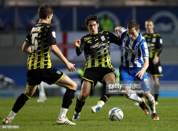 Brighton's Ashley Barnes takes on Cardiff's Peter Whittingham and Mark Hudson during the npower Championship match at the AMEX Stadium Brighton