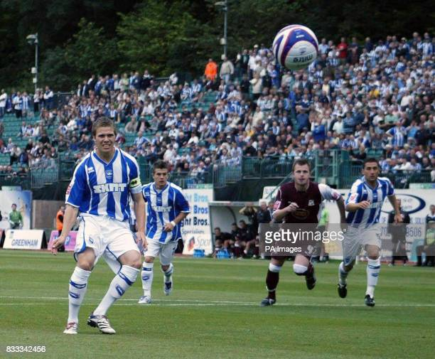 Brighton's Dean Hammond opens the scoring from the penalty spot during the CocaCola Football League One match at the Withdean Stadium Brighton