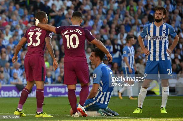 Brighton's Dutch midfielder Davy Propper and Brighton's English defender Lewis Dunk react to Dunk's own goal as Manchester City take a 20 lead during...