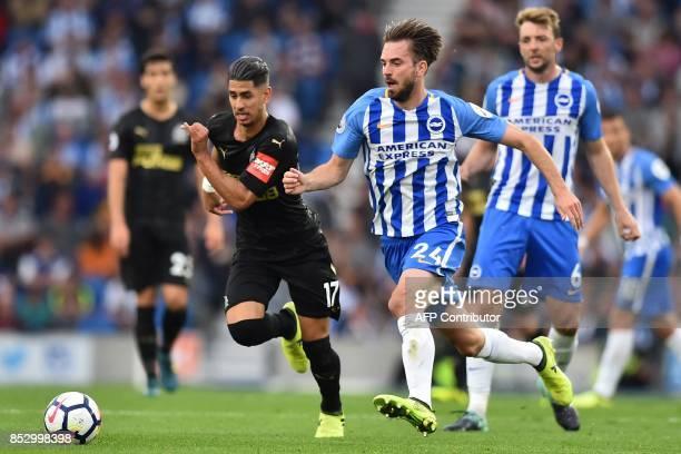 Brighton's Dutch midfielder Davy Propper vies with Newcastle United's Spanish striker Ayoze Perez during the English Premier League football match...