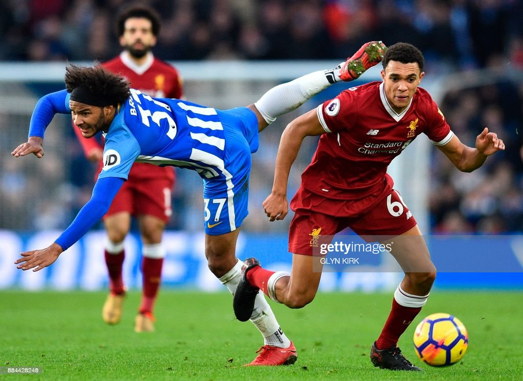 Brighton's English midfielder Izzy Brown (L) jumps against Liverpool's English midfielder Trent Alexander-Arnold (R) during the English Premier League football match between Brighton and Hove Albion and Liverpool at the American Express Community Stadium in Brighton, southern England on December 2, 2017. / AFP PHOTO / Glyn KIRK / RESTRICTED TO EDITORIAL USE. No use with unauthorized audio, video, data, fixture lists, club/league logos or 'live' services. Online in-match use limited to 75 images, no video emulation. No use in betting, games or single club/league/player publications. /