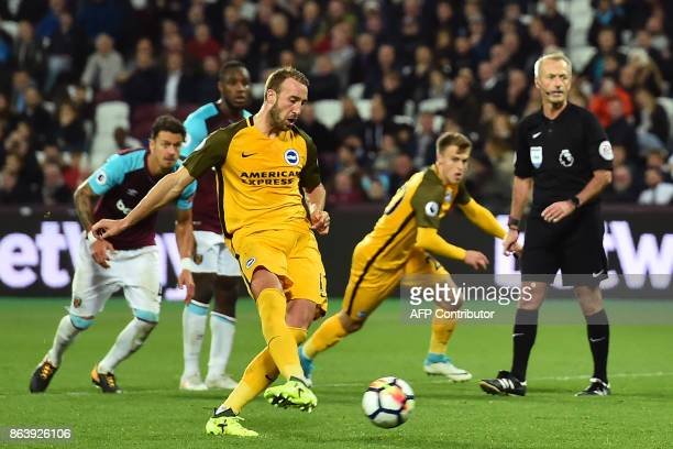 Brighton's English striker Glenn Murray scores their third goal from the penalty spot during the English Premier League football match between West...