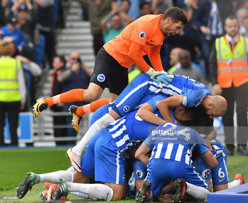 Brighton's French midfielder Anthony Knockaert celebrates with teammates scoring his team's first goal during the English Premier League football match between Brighton and Hove Albion and Everton at the American Express Community Stadium in Brighton, southern England on October 15, 2017. / AFP PHOTO / Ben STANSALL / RESTRICTED TO EDITORIAL USE. No use with unauthorized audio, video, data, fixture lists, club/league logos or 'live' services. Online in-match use limited to 75 images, no video emulation. No use in betting, games or single club/league/player publications. /