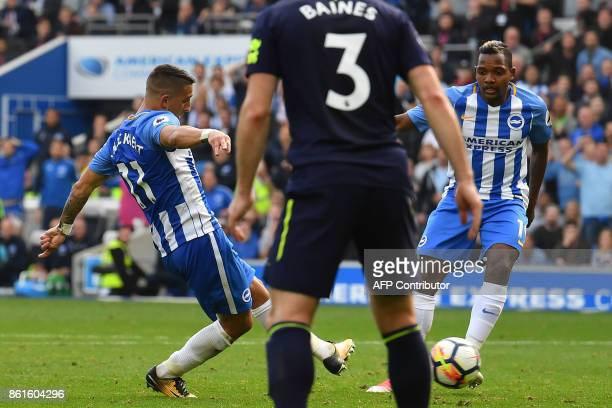 Brighton's French midfielder Anthony Knockaert scores his team's first goal during the English Premier League football match between Brighton and...