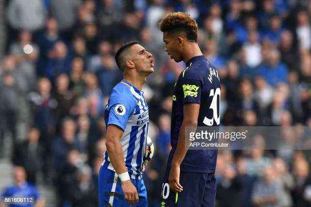 Brighton's French midfielder Anthony Knockaert stands off with Everton's English defender Mason Holgate during the English Premier League football...