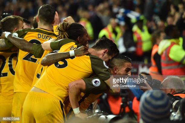 Brighton's French midfielder Anthony Knockaert stares into a photographer's camera as his teammates celebrate after their third goal during the...