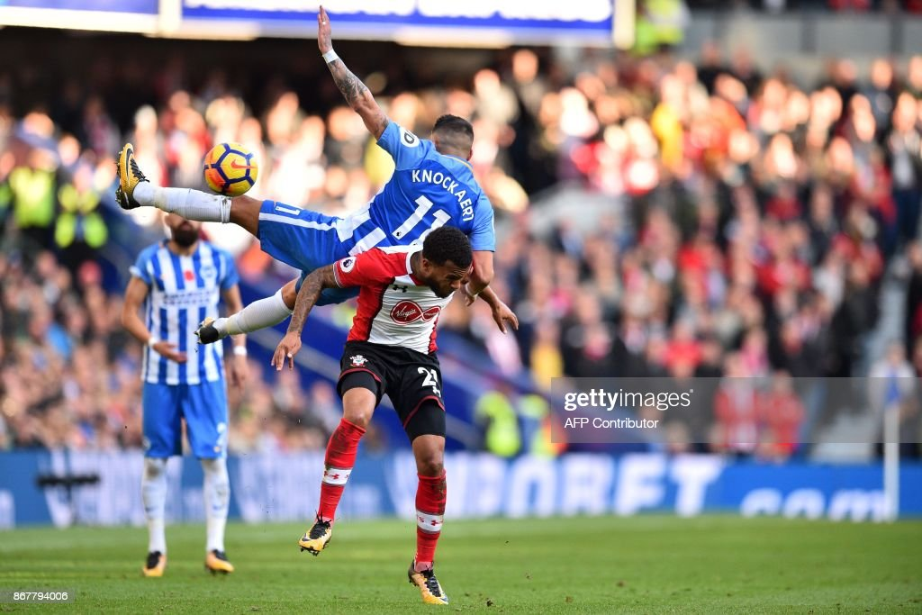 Brighton's French midfielder Anthony Knockaert (up) vies with Southampton's English defender Ryan Bertrand during the English Premier League football match between Brighton and Hove Albion and Southampton at the American Express Community Stadium in Brighton, southern England on October 29, 2017. / AFP PHOTO / Glyn KIRK / RESTRICTED TO EDITORIAL USE. No use with unauthorized audio, video, data, fixture lists, club/league logos or 'live' services. Online in-match use limited to 75 images, no video emulation. No use in betting, games or single club/league/player publications. /