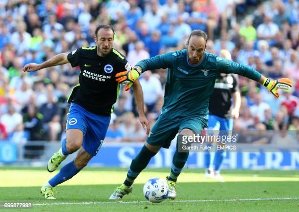 Brighton's Glenn Murray is challenged by Lazio's Ivan Vargic