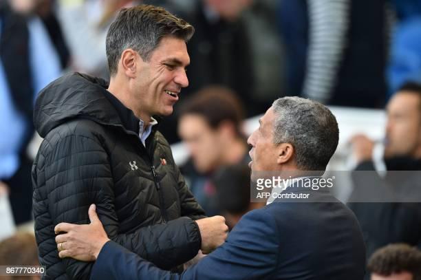 Brighton's Irish manager Chris Hughton greets Southampton's Argentinian manager Mauricio Pellegrino ahead of the English Premier League football...