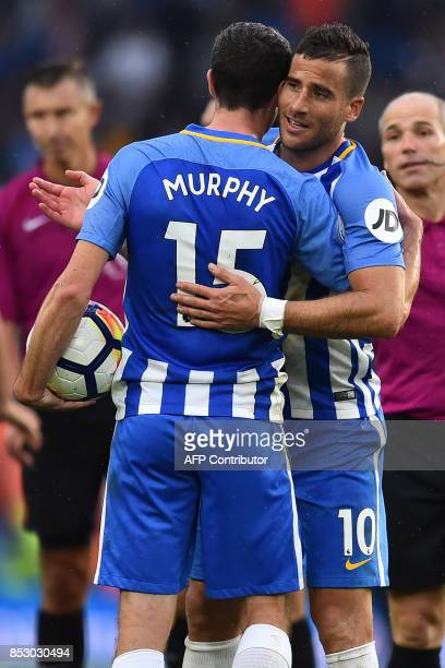 Brighton's Israeli striker Tomer Hemed celebrates on the pitch with Brighton's Scottish midfielder Jamie Murphy after the English Premier League...