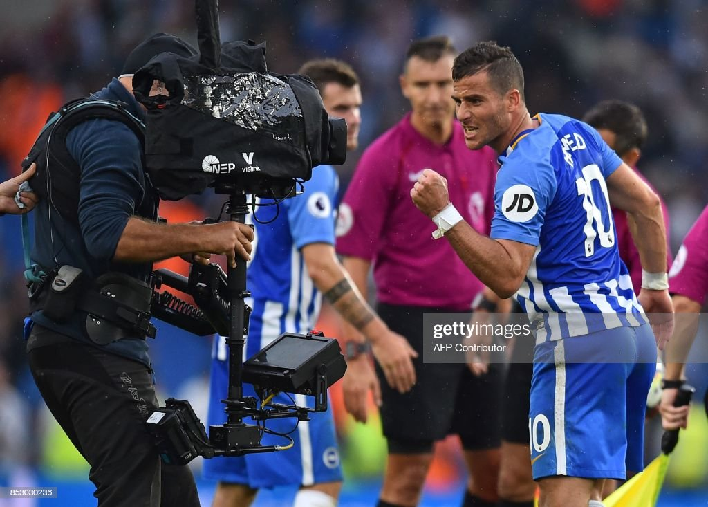 Brighton's Israeli striker Tomer Hemed (R) gestures into the TV camera as he celebrates on the pitch after the English Premier League football match between Brighton and Hove Albion and Newcastle United at the American Express Community Stadium in Brighton, southern England on September 24, 2017. Brighton won the game 1-0. / AFP PHOTO / Glyn KIRK / RESTRICTED TO EDITORIAL USE. No use with unauthorized audio, video, data, fixture lists, club/league logos or 'live' services. Online in-match use limited to 75 images, no video emulation. No use in betting, games or single club/league/player publications. /