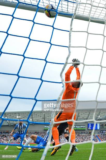 Brighton's Israeli striker Tomer Hemed scores the opening goal past Newcastle United's Englishborn Irish goalkeeper Rob Elliot during the English...