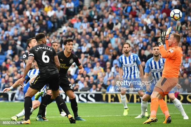Brighton's Israeli striker Tomer Hemed shoots to score the opening goal past Newcastle United's Englishborn Irish goalkeeper Rob Elliot during the...