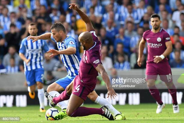 Brighton's Israeli striker Tomer Hemed vies with Manchester City's Belgian defender Vincent Kompany during the English Premier League football match...