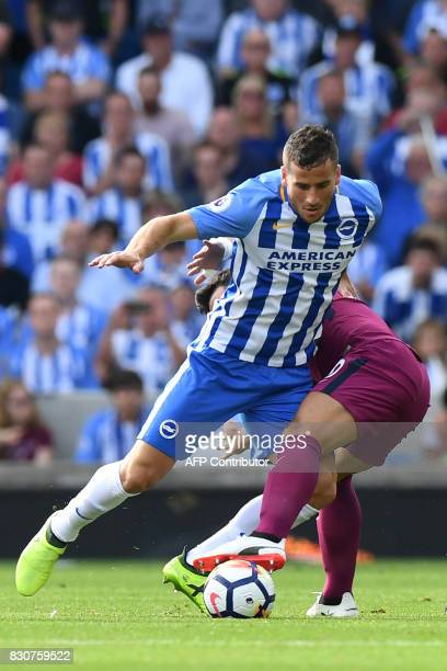 Brighton's Israeli striker Tomer Hemed vies with Manchester City's Argentinian striker Sergio Aguero during the English Premier League football match...