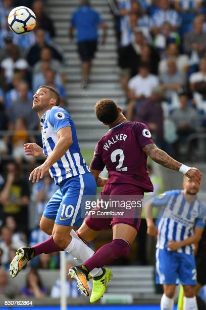 Brighton's Israeli striker Tomer Hemed vies with Manchester City's English defender Kyle Walker during the English Premier League football match...