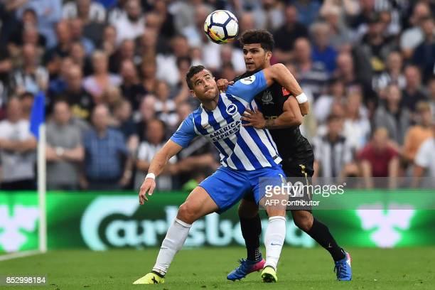 Brighton's Israeli striker Tomer Hemed vies with Newcastle United's US defender DeAndre Yedlin during the English Premier League football match...