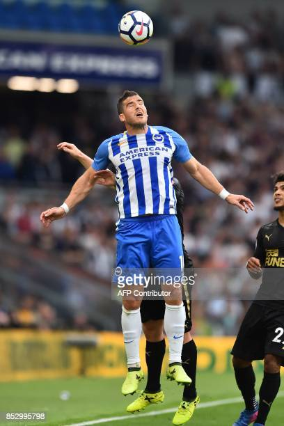 Brighton's Israeli striker Tomer Hemed wins a header during the English Premier League football match between Brighton and Hove Albion and Newcastle...