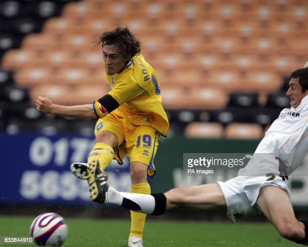 Brighton's Jake Robinson has a shot on goal as Port Vale's George Pilkington tries to stop him during the CocaCola League One match at Vale Park...