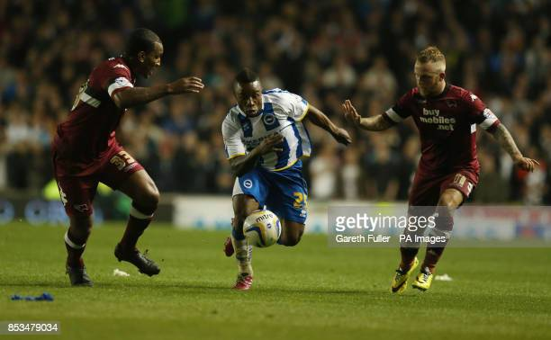 Brighton's Kazenga LuaLua moves through Derby's Andre Wisdom and Johnny Russell during the Sky Bet Championship Playoff Semi Final match at the AMEX...