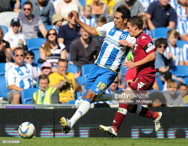 Brighton's Leonardo Ulloa is challenged by Derby's Craig Bryson during the Sky Bet Championship match at the AMEX Stadium Brighton