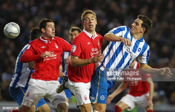 Brighton's Lewis Dunk heads towards goal challenged by Nottingham Forest's Luke Chambers and and Greg Cunningham during the npower Championship match...