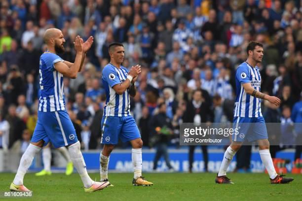 Brighton's Spanish defender Bruno Saltor Brighton's French midfielder Anthony Knockaert and Brighton's German goalkeeper Pascal Gross gesture after...