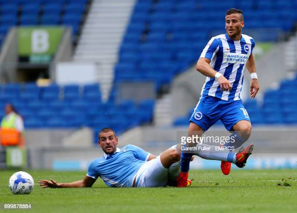 Brighton's Tomer Hemed is challenged by Lazio's Filip Djordjevic