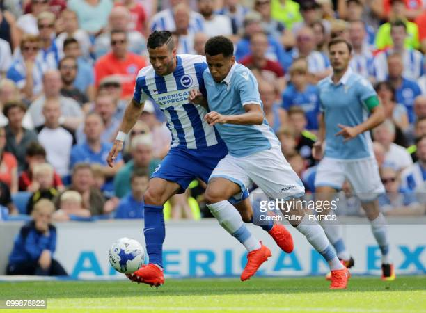 Brighton's Tomer Hemed is challenged by Lazio's Ravel Morrison