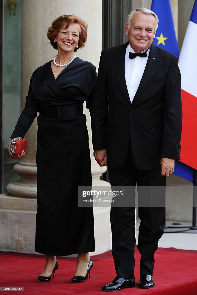 Brigitte Ayrault and <a gi-track='captionPersonalityLinkClicked' href=/galleries/search?phrase=Jean-Marc+Ayrault&family=editorial&specificpeople=551961 ng-click='$event.stopPropagation()'>Jean-Marc Ayrault</a> arrive at the Elysee Palace for a State dinner in honor of Queen Elizabeth II, hosted by French President Francois Hollande as part of a three days State visit of Queen Elizabeth II after the 70th Anniversary Of The D-Day on June 6, 2014 in Paris, France.