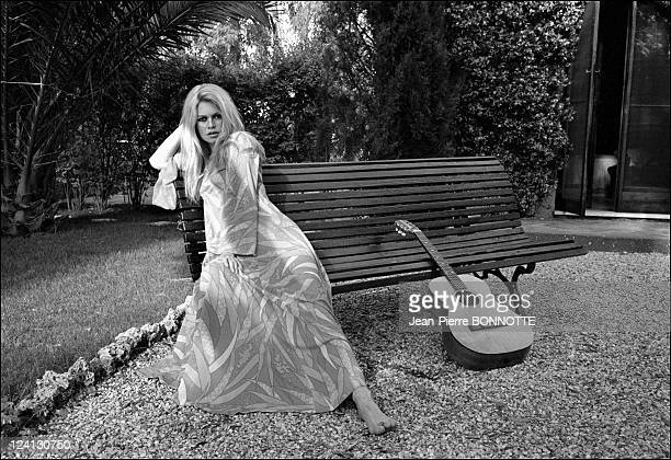 Brigitte Bardot and Gunther Sachs at home In Rome Italy In May 1967 She's with a guitar