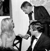 Brigitte Bardot and Paul Newman at a party for Bardot at the Beverly Hills Hotel