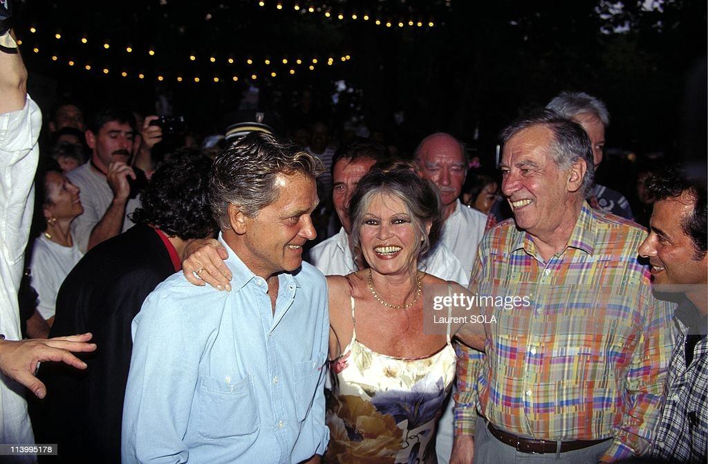 Brigitte Bardot and Roger Vadim at Cinema's 100th Birthday Party In Saint Tropez, France In July, 1995-With husband Bernard d'Ormale (L).
