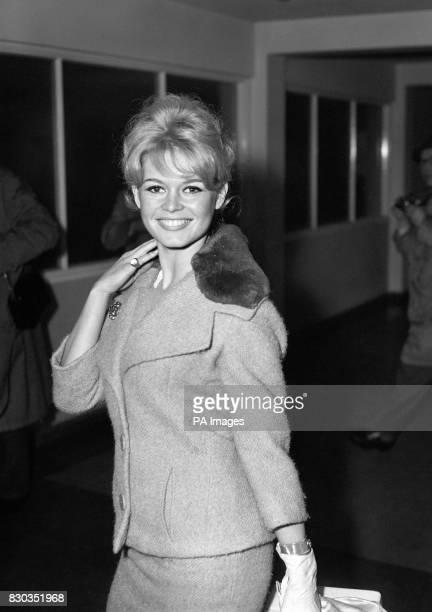Brigitte Bardot at London's Heathrow Airport London after arriving from Paris to start location shooting of her latest movie 'Babette Goes to War'