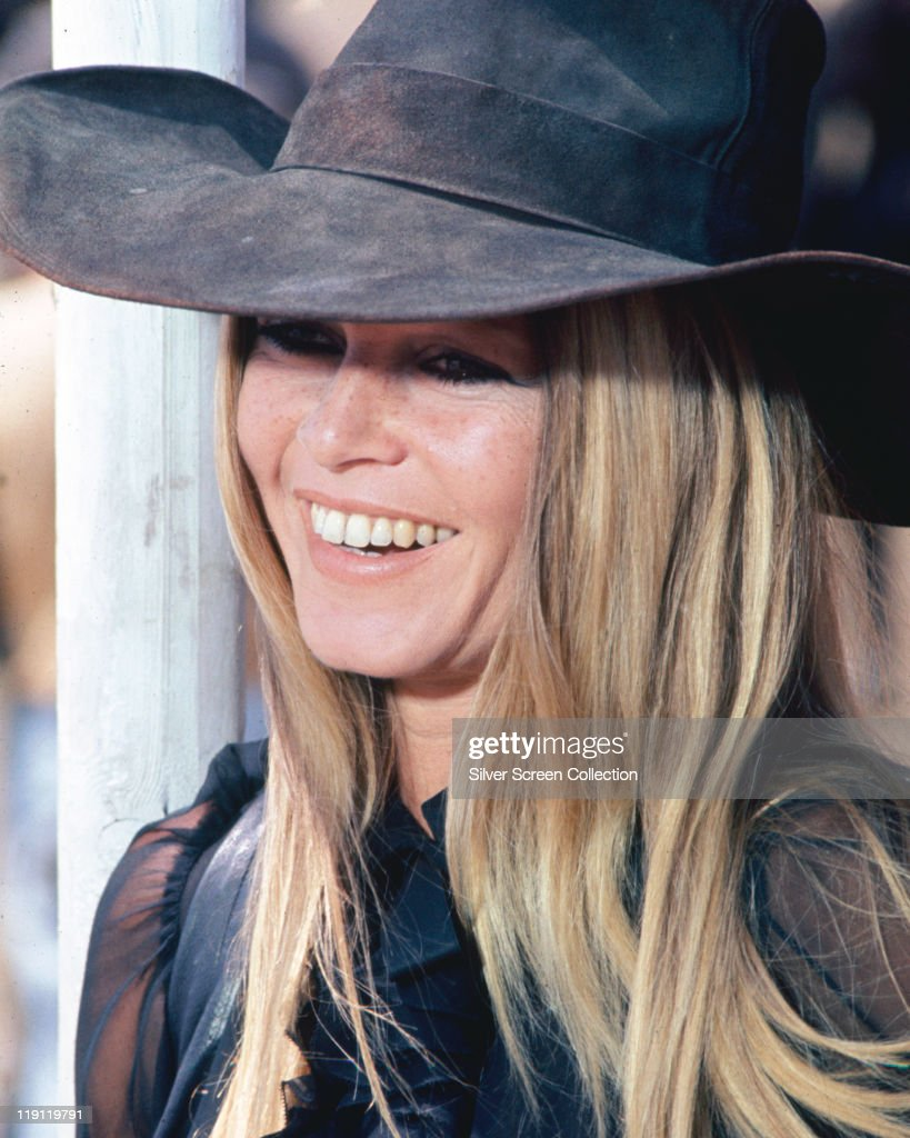 Brigitte Bardot French actress model and singer wearing a widebrimmed hat and smiling in a publicity image for the film 'Les Petroleuses' 1971 Also...