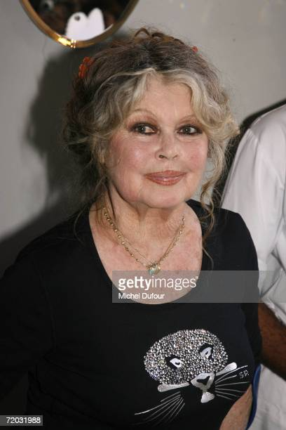 Brigitte Bardot gets ready to cut the party cake at The Brigitte Bardot Foundation's anniversary party at the Marigny Theater near the Champs Elysees...