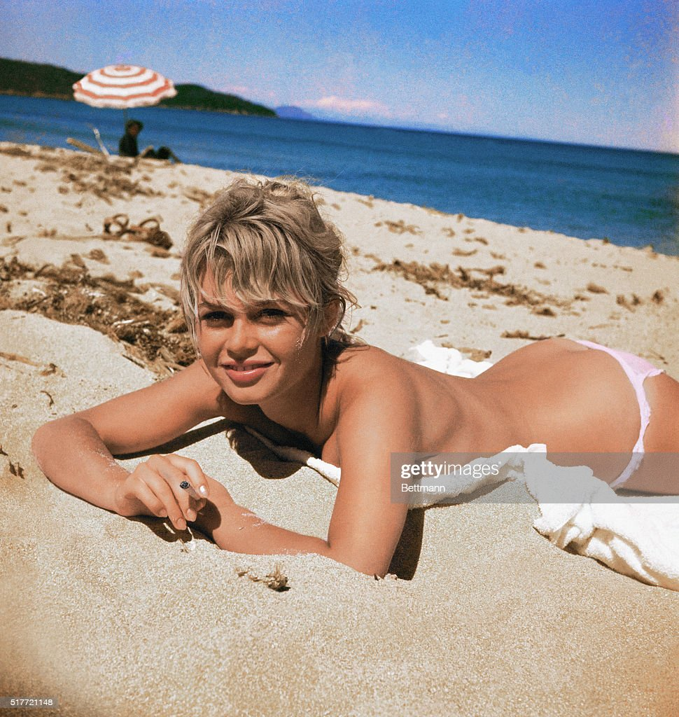 <a gi-track='captionPersonalityLinkClicked' href=/galleries/search?phrase=Brigitte+Bardot&family=editorial&specificpeople=202903 ng-click='$event.stopPropagation()'>Brigitte Bardot</a>, originally Camille Javal, actress, pictured here on a towel, sunning on the beach.