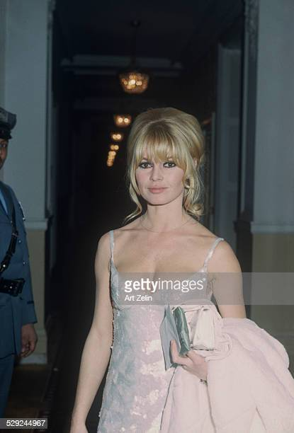 Brigitte Bardot wearing a white evening dress at the Plaza Hotel circa 1970 New York