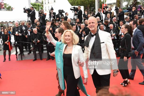 Brigitte Fossey and Larry Cech attend 'Amant Double ' Red Carpet Arrivals during the 70th annual Cannes Film Festival at Palais des Festivals on May...