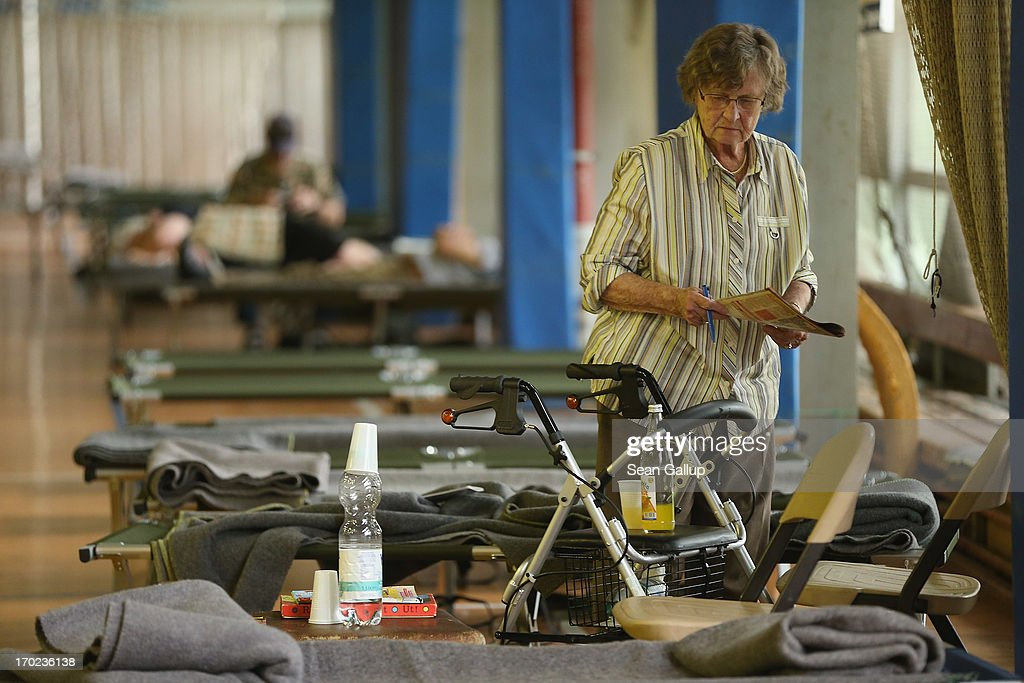 Brigitte Ilsmann, 88, prepares to read a magazine in an evacuation center administered by the German Red Cross (DRK) for people forcred to flee their homes due to rising floodwaters from the Elbe river on June 9, 2013 in Magdeburg, Germany. Magdeburg is enduring its highest floodwaters in its 1,200 year history and local authorities have called on 23,000 residents to evacuate their homes. Catastrophic flooding has hit portions of southern and eastern Germany that has left at least seven people dead and forced tens of thousands to flee their homes. Towns in northern Germany downstream from the Elbe are also bracing for floods in coming days.