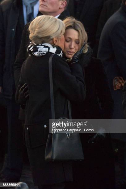 Brigitte Macron and Laura Smet during Johnny Hallyday's Funeral at Eglise De La Madeleine on December 9 2017 in Paris France France pays tribute to...