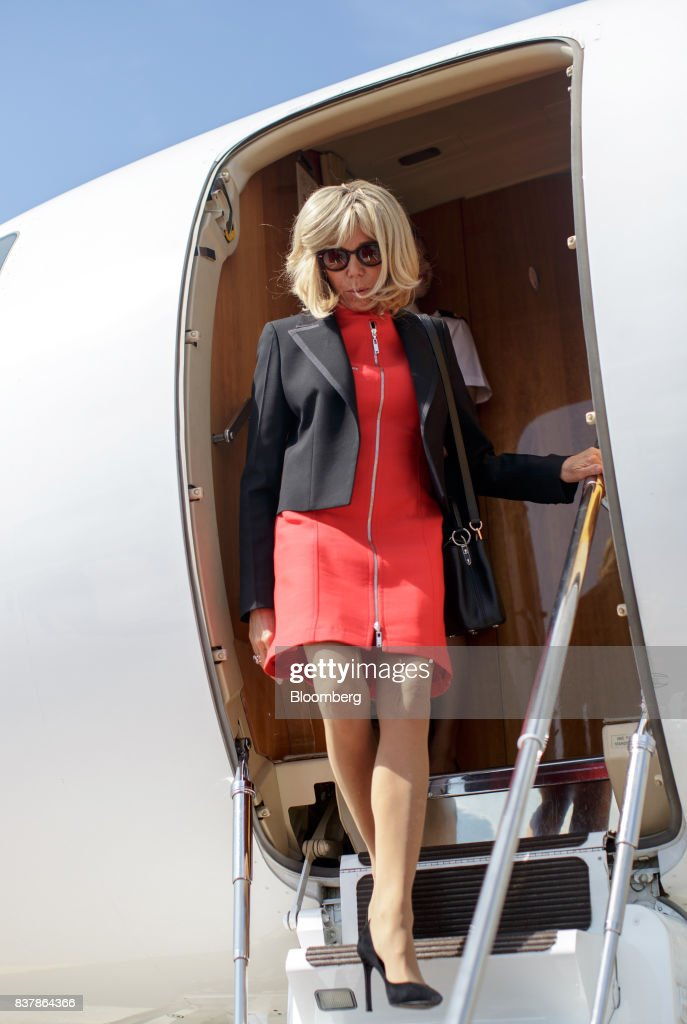Brigitte Macron, France's first lady, disembarks an airplane at Salzburg Airport in Salzburg, Austria, on Wednesday, Aug. 23, 2017. Macron kicks of a European Union diplomatic blitz Wednesday seeking nothing less than to reshape the blocs stance on subjects ranging from cheap labor to defense and border controls. Photographer: Lisi Niesner/Bloomberg via Getty Images