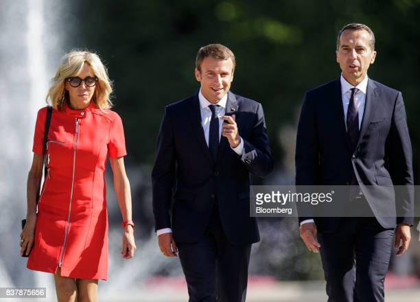 Brigitte Macron France's first lady left Emmanuel Macron France's president center and Christian Kern Austria's chancellor walk through the Mirabell...